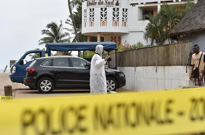 An investigator walks in front of the Hotel Etoile du Sud in Grand Bassam, Ivory Coast, on March 14, 2016, a day after jihadist attackers stormed three hotels in the weekend resort (AFP Photo/Issouf Sanogo)