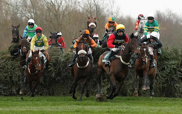 Horse Racing - Grand National Festival - Aintree Racecourse, Liverpool, Britain - April 13, 2018 Ultragold ridden by Harry Cobden leads the field before winning the 16:05 Randox Health Topham Handicap Chase Action Images via Reuters/Matthew Childs