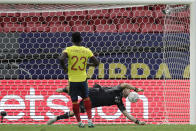 Argentina's goalkeeper Emiliano Martinez blocks a penalty shot by Colombia's Davinson Sanchez in a penalty shootout during a Copa America semifinal soccer match at the National stadium in Brasilia, Brazil, Wednesday, July 7, 2021. (AP Photo/Eraldo Peres)