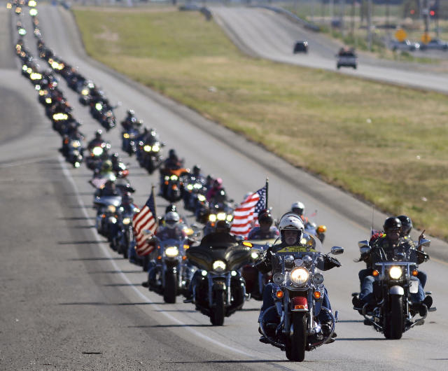 <p>Hundreds of motorcyclists make their way on Highway 191 toward Odessa, Texas on their way to Andrews Monday morning, May 29, 2017 during the Memorial Day Ride to Remember. The ride begins with a ceremony at the Permian Basin Vietnam Memorial and ends with a wreath ceremony at the Andrews War Memorial. (Photo: Mark Sterkel/Odessa American via AP) </p>