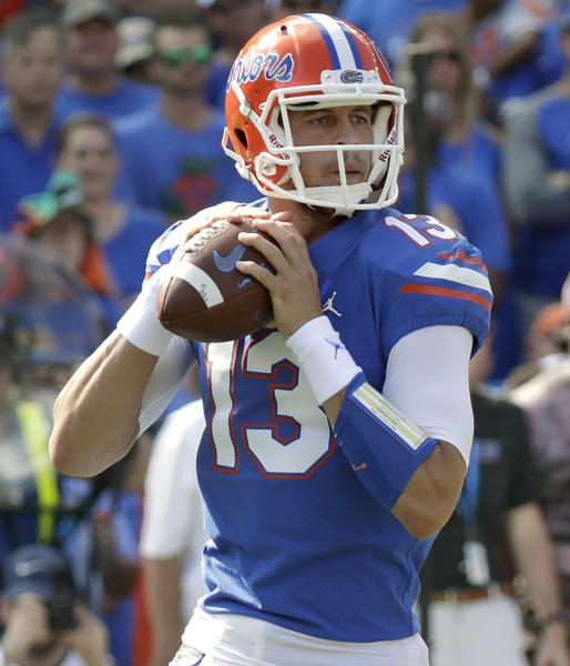 FILE - In this Oct. 6, 2018, file photo, Florida quarterback Feleipe Franks looks for a receiver against LSU during the first half of an NCAA college football game in Gainesville, Fla. Florida and Miami have the college football stage to themselves for 3 hours Saturday, a new chapter in their once-heated and forever-storied rivalry. (AP Photo/John Raoux, File)