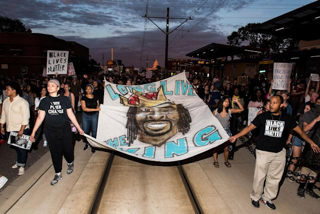 <p>Protestors carry a banner depicting Philando Castile on June 16, 2017 in St Paul, Minnesota. Protests erupted in Minnesota after Officer Jeronimo Yanez was acquitted on all counts in the shooting death of Philando Castile. (Stephen Maturen/Getty Images) </p>