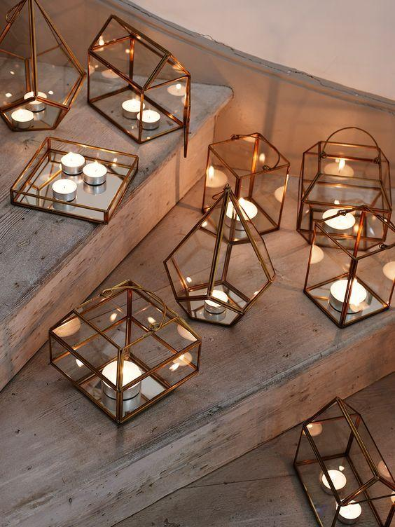 "<p>""No candles, no hygge,"" Meik Wiking author of <i>The Little Book Of Hygge </i>writes in his book. Simple. And it makes sense - after a long day in a harshly lit office, curling up by candlelight will make you feel instantly at ease. Pick up plenty of tea lights and light them in clusters for a soft, atmospheric light. <i>[Photo: Pinterest/AtHomeWithAbby]</i></p>"