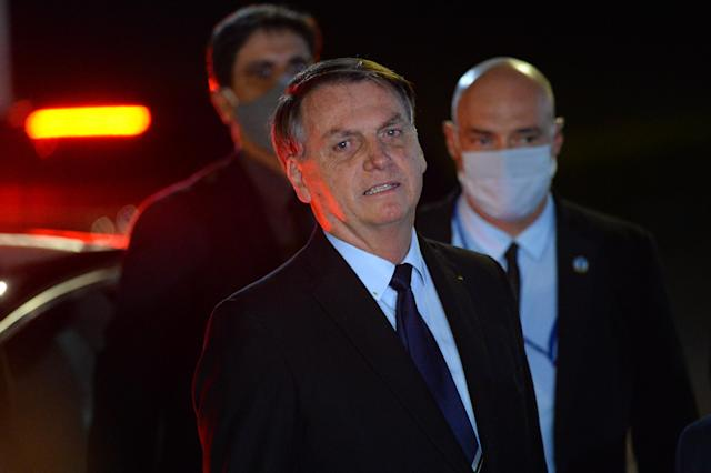 BRASILIA, BRAZIL - JUNE 05: President of Brazil Jair Bolsonaro reacts during a conference with the press and supporters at Alvorada Palace on June 05, 2020 in Brasilia, Brazil. Brazil has over 614,000 confirmed positive cases of Coronavirus and OVER 34,000 deaths. (Photo by Andressa Anholete/Getty Images)