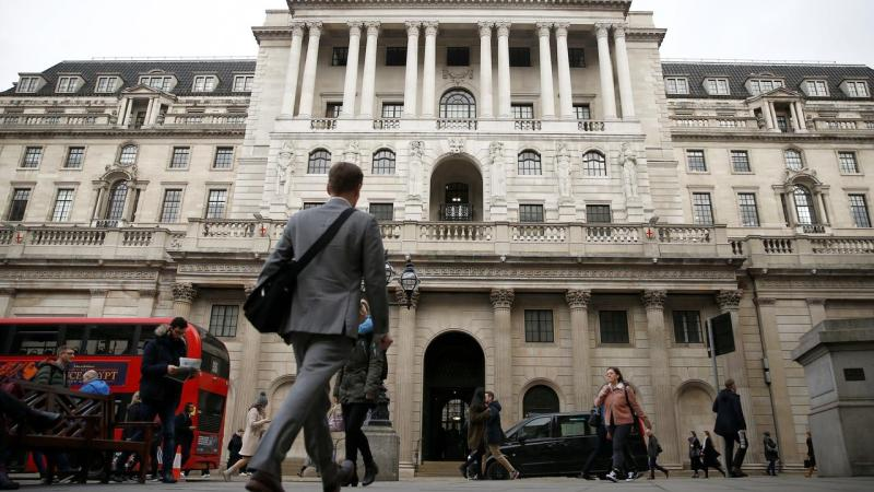 A man walks in front of Bank of England