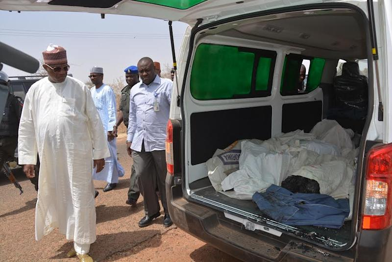 Ibrahim Gaidam, Governor of Yobe state, left, look at bodies of students inside an ambulance outside a mosque in Damaturu, Nigeria, Tuesday, Feb. 25, 2014. Islamic militants killed 29 students in a pre-dawn attack Tuesday on a northeast Nigerian school some 45 miles from the city, survivors said, setting ablaze a locked dormitory and shooting and slitting the throats of those who escaped through windows. Some were burned alive. (AP Photo)