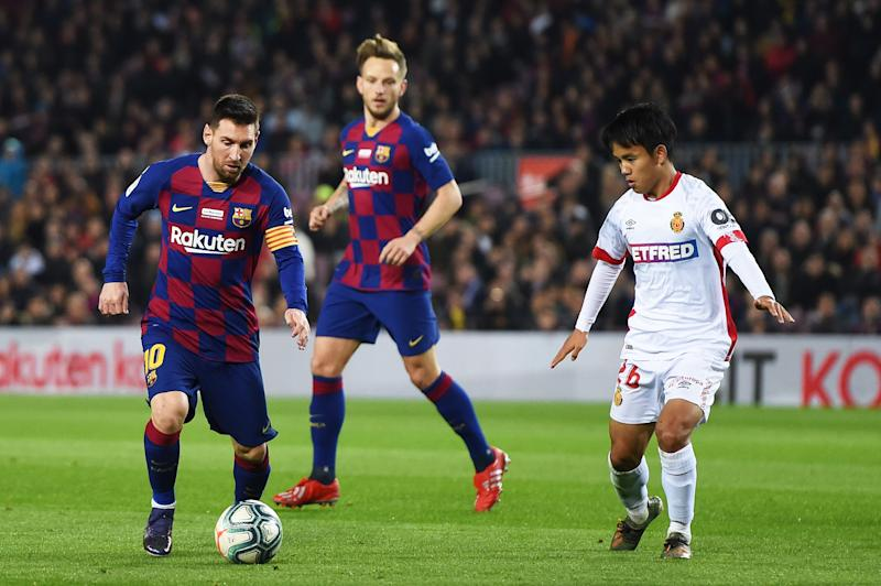 BARCELONA, SPAIN - DECEMBER 07: Lionel Messi of FC Barcelona runs with the ball under pressure from Takefusa Kubo of RCD Mallorca during the Liga match between FC Barcelona and RCD Mallorca at Camp Nou on December 07, 2019 in Barcelona, Spain. (Photo by Alex Caparros/Getty Images)