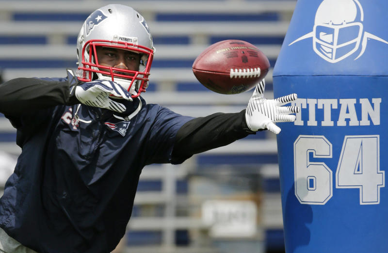 "File-This June 17, 2014, file photo shows New England Patriots cornerback Darrelle Revis reaching for a pass during NFL football minicamp in Foxborough, Mass. Revis, while with the New York Jets in 2012, called Belichick a ""jerk."" Now, it seems, they've made up. ""We had a conversation about it and it's in the past,"" Revis said after joining the Patriots. Since then, he's seen a more positive side of Belichick. (AP Photo/Charles Krupa, File)"