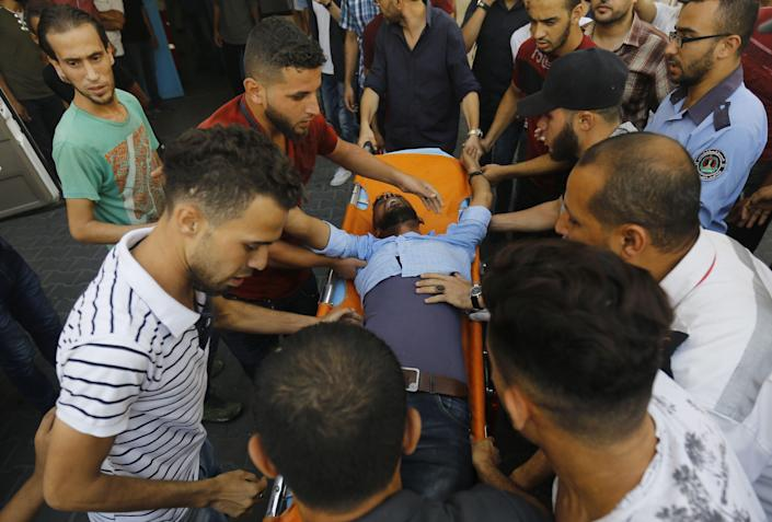 <p>A wounded Palestinian man is brought into al-Shifa hospital on Aug. 9, 2018, following an Israeli airstrike on Gaza City. (Photo: Anas Baba/AFP/Getty Images) </p>