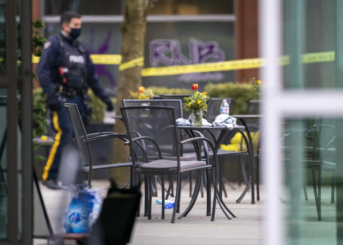 Members of the police are seen outside of the Lynn Valley Library, in North Vancouver, British Columbia, Saturday, March 27, 2021. Police say multiple victims were stabbed inside and outside the library today. (Jonathan Hayward/The Canadian Press via AP)
