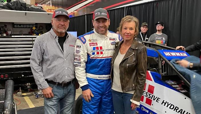 Greg Newman stands with son, Ryan, and wife, Diane, at the 2020 Chili Bowl. Greg was a Cup spotter for Ryan for many year of his NASCAR career.