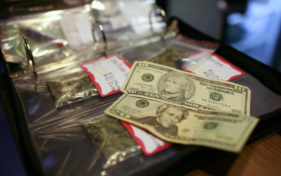 A cash transaction for medical marijuana is shown at Coffehouse Blue Sky in Oakland, California, July 23, 2009.