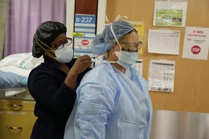 Staff at Maimonides Medical Center in Brooklyn don protective gear to treat COVID-19 patients.