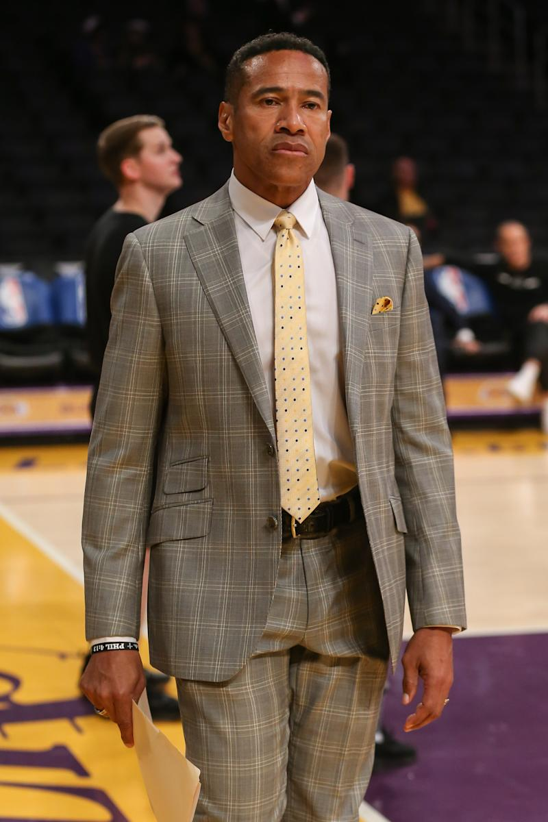 Mark Jones in a suit ahead of a game.