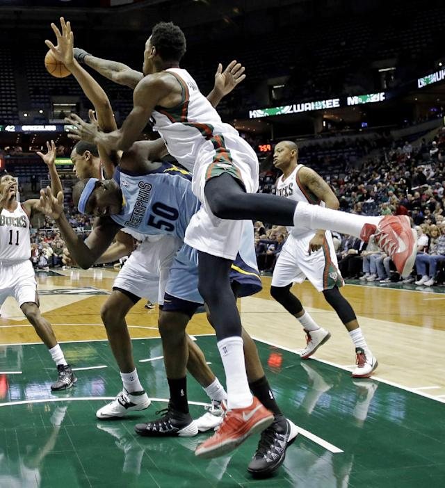 Milwaukee Bucks' Larry Sanders blocks a shot by Memphis Grizzlies' Zach Randolph (50) during the first half of an NBA basketball game on Wednesday, Jan. 15, 2014, in Milwaukee. (AP Photo/Morry Gash)