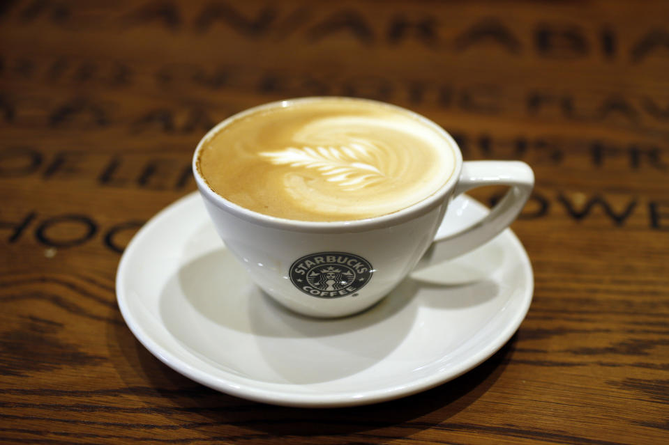 A cup of coffee sits on a table in Starbucks' Vigo Street branch in Mayfair, central London January 11, 2013.  REUTERS/Stefan Wermuth (BRITAIN - Tags: BUSINESS LOGO FOOD)