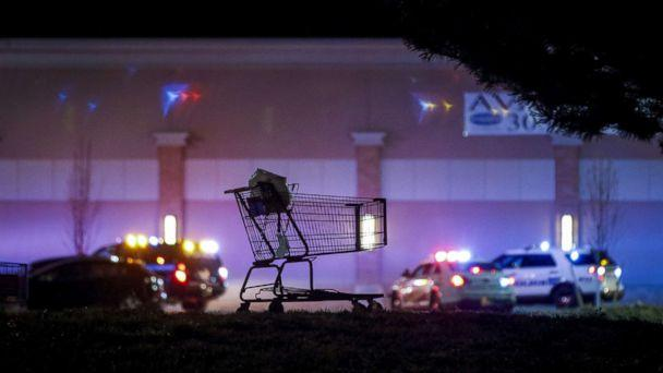 PHOTO: A shopping cart sits in the parking lot as police investigate the scene of a shooting at a Walmart store, Nov. 1, 2017 in Thornton, Colo. (Marc Piscotty/Getty Images)