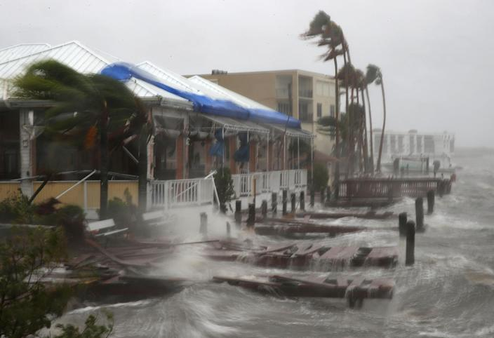 Heavy waves caused by Hurricane Matthew pound the boat docks at the Sunset Bar and Grill in Cocoa Beach, Fla., on Oct. 7, 2016. (Photo: Mark Wilson/Getty Images)