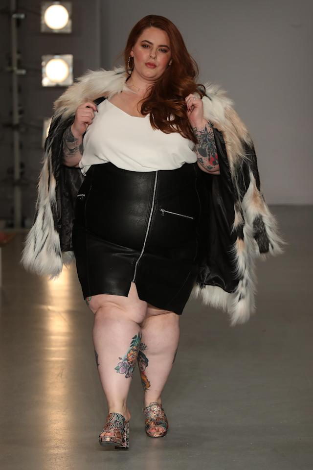 <p>Strutting her stuff in a leather skirt and fur jacket. </p>