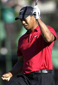 Tiger Woods reacts to his approach shot on the 13th fairway during the final round