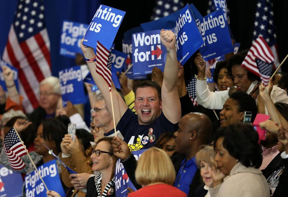 <p>Supporters of Democratic presidential candidate Hillary Clinton cheer at a primary night party in Columbia, S.C., on Saturday, as TV networks project her to be the winner. <i>(Photo: Randall Hill/Reuters)</i></p>
