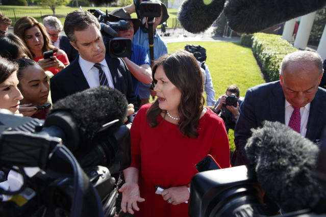 Press secretary Sarah Sanders talks to reporters outside the White House on May 3. (Photo: Evan Vucci/AP)
