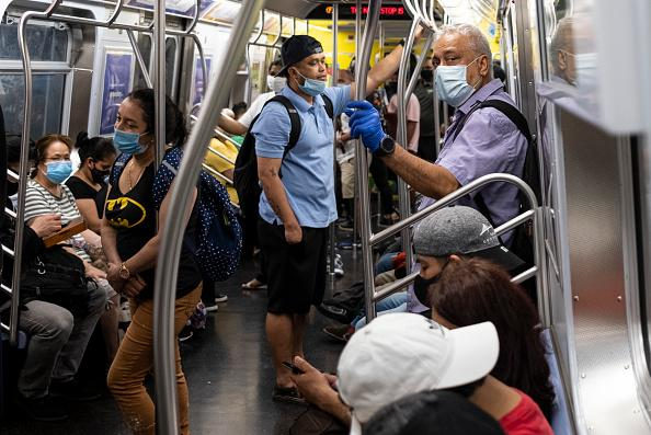 People stand in a subway train during rush hour amid the coronavirus pandemic in New York City.