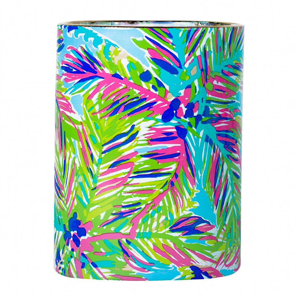 "<p>$32 | <a rel=""nofollow"" href='https://www.lillypulitzer.com/product/accessories-shoes/printed-drinkware-gifts/scented-glass-candle/pc/61/c/397/9568.uts?swatchName=Multi+Ocean+Jewels'>Lilly Pulitzer</a></p>"