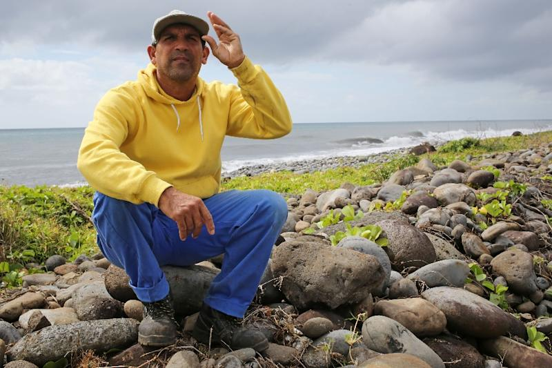 Johnny Begue, who stumbled across a piece of plane wreckage from the ill-fated Malaysia Airlines flight MH370 on the beach, poses in Saint-Andre on the east of the French island of La Reunion, on August 6, 2015