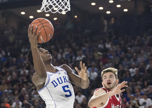 Duke's R.J. Barrett (5) goes up for two points as McGill Redmen's Noah Daoust defends during third quarter exhibition basketball action in Laval, Quebec, Sunday, Aug. 19, 2018. (Graham Hughes/The Canadian Press via AP)