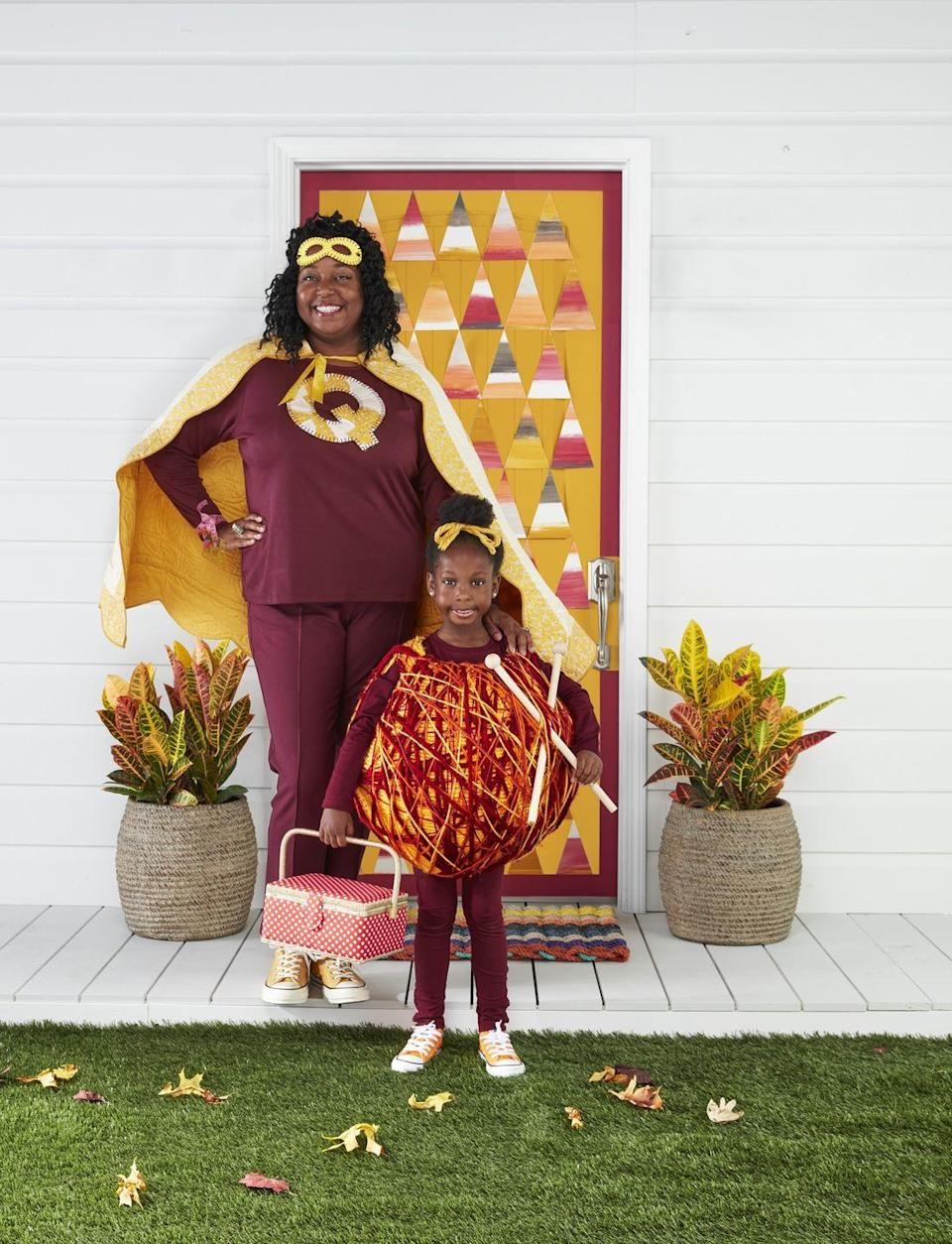 """<p>It's a bird, it's a plane, it's Korliss and Zoe, here to save the universe one stitch at a time! This stylish superhero duo comes armed with a superhuman eye for detail.</p><p><strong>Make the Quilt Mom Costume:</strong> Cut a quilt into a trapezoid shape; sew a corresponding color bias tape around the edges to finish. At the top corner of the trapezoid, sew a corresponding color ribbon for ties. Use a scrap of the quilt to cut out an oversize letter """"Q"""" and blanket stitch it to the front of a T-shirt. Blanket stitch around the edges of a felt superhero mask and round out the look with a tailor tape measure bracelet adorned with sewing charms. Glue a metal thimble to a silver ring blank to create a superpower ring. </p><p><strong> Make the Yarn Ball Costume: </strong>Measure child's shoulder width and head diameter. Blow up an 18- to 24-inch round balloon or beach ball (the size will depend on child's height). Mold <a href=""""https://www.amazon.com/Craft-Wrap-Plaster-Bandage-Single/dp/B000F5VHQQ?tag=syn-yahoo-20&ascsubtag=%5Bartid%7C10050.g.29074815%5Bsrc%7Cyahoo-us"""" rel=""""nofollow noopener"""" target=""""_blank"""" data-ylk=""""slk:CraftWrap"""" class=""""link rapid-noclick-resp"""">CraftWrap</a> around the balloon or ball, leaving wide enough openings on the top (for the head) and the bottom (for the head and shoulders) to pass through; allow to dry.</p><p>Remove balloon or beach ball. Adjust openings if needed and use an X-Acto knife to cut out armholes. Coil a base layer of <a href=""""https://www.amazon.com/Caron-Simply-Paints-Worsted-Acrylic/dp/B06XGTPL73?tag=syn-yahoo-20&ascsubtag=%5Bartid%7C10050.g.29074815%5Bsrc%7Cyahoo-us"""" rel=""""nofollow noopener"""" target=""""_blank"""" data-ylk=""""slk:thick yarn"""" class=""""link rapid-noclick-resp"""">thick yarn</a> (we used mustard yellow) around the form, hot-gluing it in place as you go. Attach autumnal <a href=""""https://www.amazon.com/Caron-Simply-Paints-Worsted-Acrylic/dp/B06XGTPL73?tag=syn-yahoo-20&ascsubtag=%5Bartid%7C10050.g.29074815%5Bsrc%7Cyahoo-us"""" rel"""