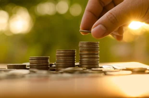 CBC finance columnist Mark Ting says saving is good, but those savings will have a greater impact if they're invested.  (Shutterstock/Singkham - image credit)