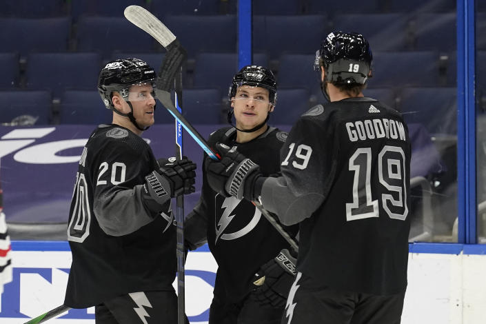 Tampa Bay Lightning center Yanni Gourde (37) celebrates his goal against the Chicago Blackhawks with center Blake Coleman (20) and right wing Barclay Goodrow (19) during the second period of an NHL hockey game Saturday, March 20, 2021, in Tampa, Fla. (AP Photo/Chris O'Meara)