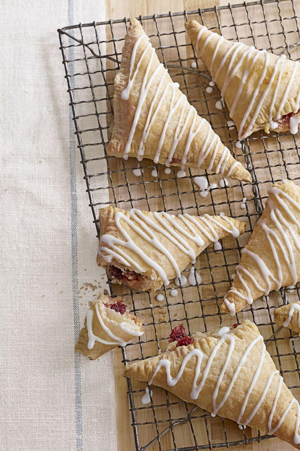 "<p>It's time we stop relegating cranberry sauce to the edge of the table (in a small serving bowl, no less). Here, the tart sauce shines as the filling of a sinfully sweet puff pastry. </p><p><em><a href=""https://www.goodhousekeeping.com/food-recipes/a11258/cranberry-turnovers-recipe-clx1111/"" rel=""nofollow noopener"" target=""_blank"" data-ylk=""slk:Get the recipe for Cranberry Turnovers »"" class=""link rapid-noclick-resp"">Get the recipe for Cranberry Turnovers »</a></em></p>"