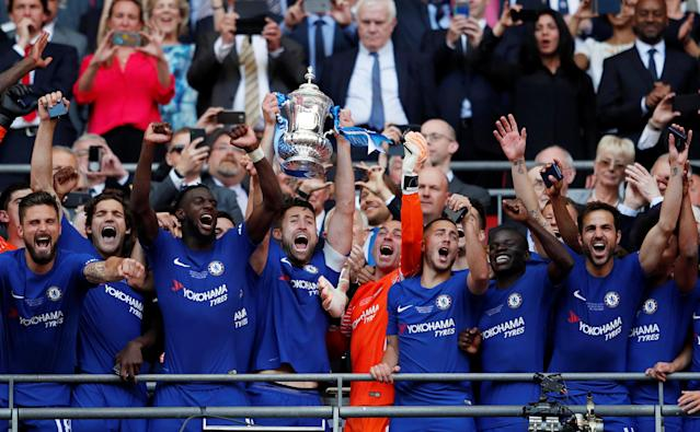 Soccer Football - FA Cup Final - Chelsea vs Manchester United - Wembley Stadium, London, Britain - May 19, 2018 Chelsea's Gary Cahill celebrates winning the FA Cup by lifting the trophy alongside team mates Action Images via Reuters/Lee Smith
