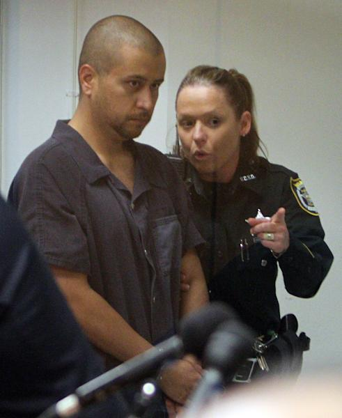 George Zimmerman is directed by a Seminole County Deputy during a court hearing Thursday, April 12, 2012, in Sanford, Fla. Zimmerman has been charged with second-degree murder in the shooting death of the 17-year-old Trayvon Martin. (AP Photo/Gary W. Green, Orlando Sentinel, Pool)