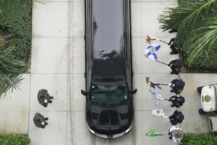 Family members arrive in the procession behind the hearse carrying the casket of FBI Special Agent Laura Schwartzenberger as they arrive at the memorial service Saturday, Feb. 6, 2021, in Miami Gardens, Fla. Schwartzenberger and Special Agent Daniel Alfin were killed while serving a warrant this week in Sunrise, Fla. (AP Photo/Hans Deryk)