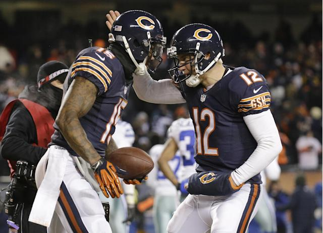 Chicago Bears wide receiver Brandon Marshall (15) and quarterback Josh McCown (12) celebrate after making a two-point conversion during the second half of an NFL football game against the Dallas Cowboys, Monday, Dec. 9, 2013, in Chicago. (AP Photo/Nam Y. Huh)