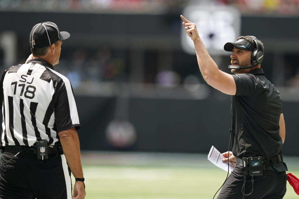 Philadelphia Eagles head coach Nick Sirianni speaks to an offical during the first half of an NFL football game between the Atlanta Falcons and the Philadelphia Eagles, Sunday, Sept. 12, 2021, in Atlanta. (AP Photo/Brynn Anderson)
