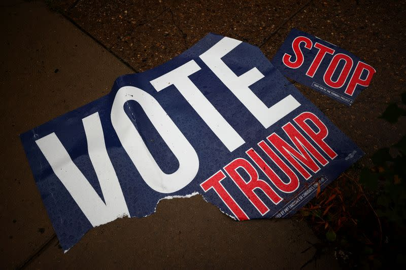 A torn voting sign lies on the pavement, in Philadelphia, Pennsylvania