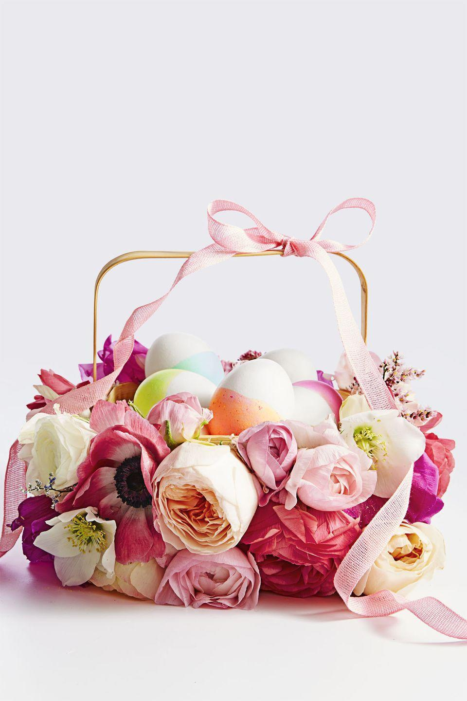 """<p>First, use this basket to collect sweets. Then, leave it out on the table as an eye-catching centerpiece. To make, simply glue a variety of faux blooms around the base of the basket and top it off with a bow. <br><br><a class=""""link rapid-noclick-resp"""" href=""""https://www.amazon.com/Luyue-Vintage-Artificial-Flowers-Decoration/dp/B01CVM5YKU/?tag=syn-yahoo-20&ascsubtag=%5Bartid%7C10055.g.480%5Bsrc%7Cyahoo-us"""" rel=""""nofollow noopener"""" target=""""_blank"""" data-ylk=""""slk:SHOP FAKE FLOWERS"""">SHOP FAKE FLOWERS</a></p><p><strong>RELATED: </strong><a href=""""https://www.goodhousekeeping.com/holidays/easter-ideas/g1906/easter-flowers/"""" rel=""""nofollow noopener"""" target=""""_blank"""" data-ylk=""""slk:Gorgeous Easter Flowers and Centerpieces"""" class=""""link rapid-noclick-resp"""">Gorgeous Easter Flowers and Centerpieces </a></p>"""