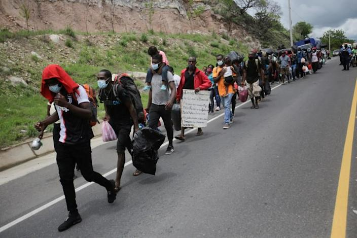 African, Cuban and Haitian migrants, which are stranded in Honduras after borders were closed due to the coronavirus (COVID-19) outbreak, trek northward in an attempt to reach the United States, in Choluteca