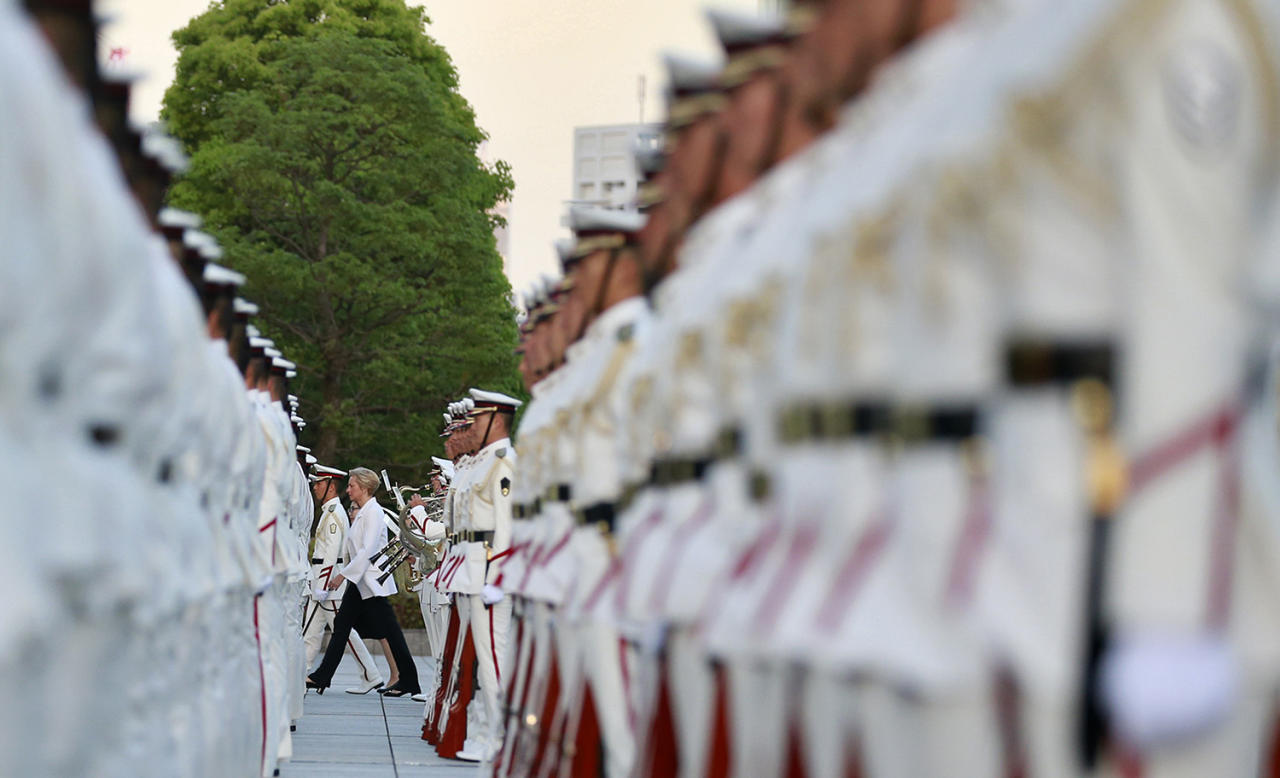 <p>Italian Defense Minister Roberta Pinotti walks as she reviews an honor guard with her Japanese counterpart Tomomi Inada, partially seen behind Pinotti, at the Defense Ministry in Tokyo, Monday, May 22, 2017. (AP Photo/Shizuo Kambayashi) </p>