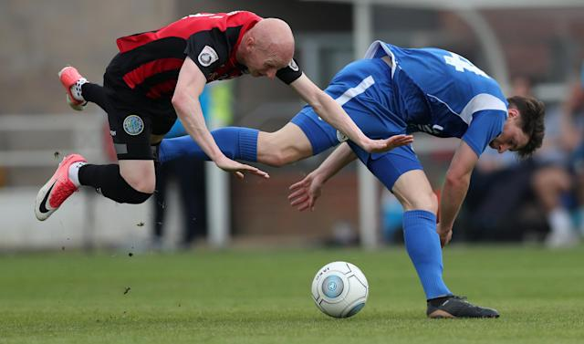 "Soccer Football - National League - Eastleigh v Macclesfield Town - The Silverlake Stadium, Eastleigh, Britain - April 21, 2018 Eastleigh's Cavanagh Miley in action with Macclesfield Town's Danny Whittaker Action Images/Peter Cziborra EDITORIAL USE ONLY. No use with unauthorized audio, video, data, fixture lists, club/league logos or ""live"" services. Online in-match use limited to 75 images, no video emulation. No use in betting, games or single club/league/player publications. Please contact your account representative for further details."