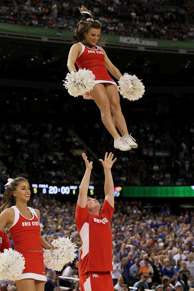 NEW ORLEANS, LA - MARCH 31:  The Ohio State Buckeyes cheerleaders perform before the Buckeyes take on the Kansas Jayhawks in the National Semifinal game of the 2012 NCAA Division I Men's Basketball Championship at the Mercedes-Benz Superdome on March 31, 2012 in New Orleans, Louisiana.  (Photo by Chris Graythen/Getty Images)