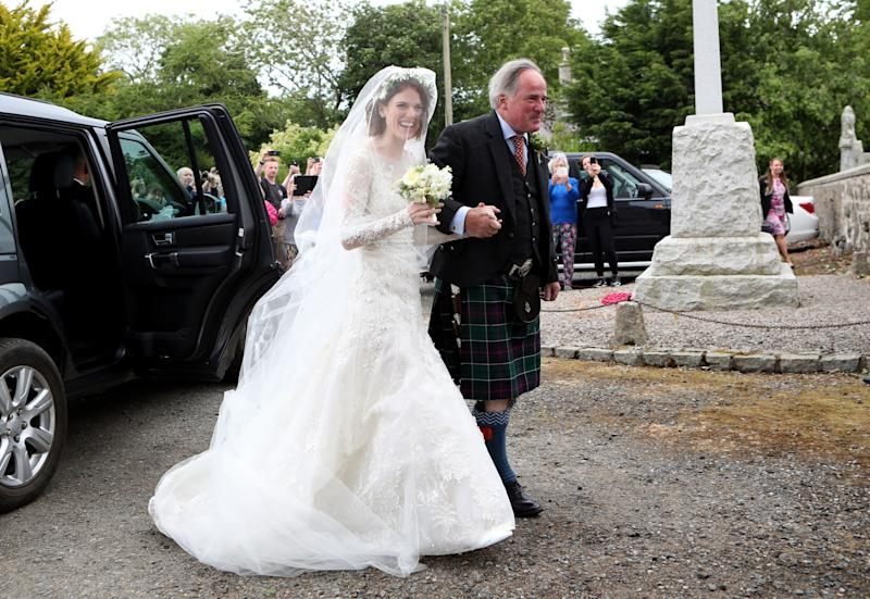 Rose Leslie with her father Sebastian Leslie arrive at Rayne Church, Kirkton of Rayne in Aberdeenshire, for her wedding ceremony with Game Of Thrones co-star Kit Harington. (Photo by Jane Barlow/PA Images via Getty Images)