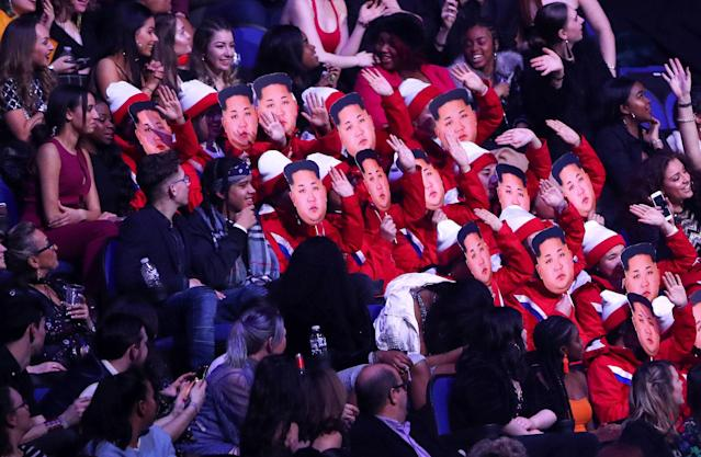 Spectators wear Kim Jong-un masks as they impersonate the North Korean cheerleaders at the Winter Olympic Games at the Brit Awards at the O2 Arena in London, Britain, February 21, 2018. REUTERS/Hannah McKay