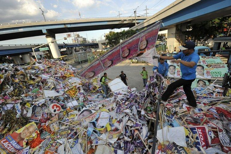 Philippine workers discared election banners and posters at a depot in Manila on May 11, 2010