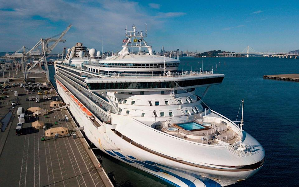 Pictured in March, a cruise ship evacuating passengers amid Covid concerns in California - AFP