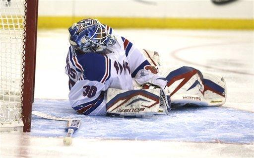 New York Rangers goalie Henrik Lundqvist, of Sweden, lays on the ice during the second period of an NHL hockey game against the New Jersey Devils , Tuesday, March 19, 2013, in Newark, N.J. (AP Photo/Julio Cortez)